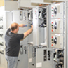 Sample project photo showing a man working on an open control panel
