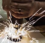 Sparks flying off a metal sander